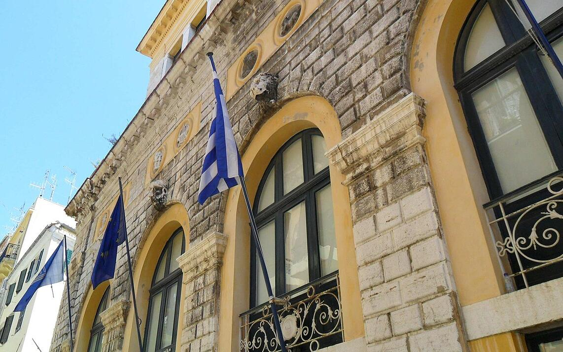 Flags and architecture on the island of Corfu, Greece