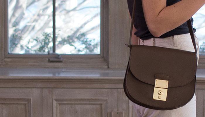 Lotuff Leather Arc Handbag in indigo