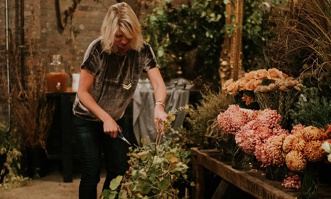 Semia Dunne of Flowers by Semia, at work in her Providence design studio