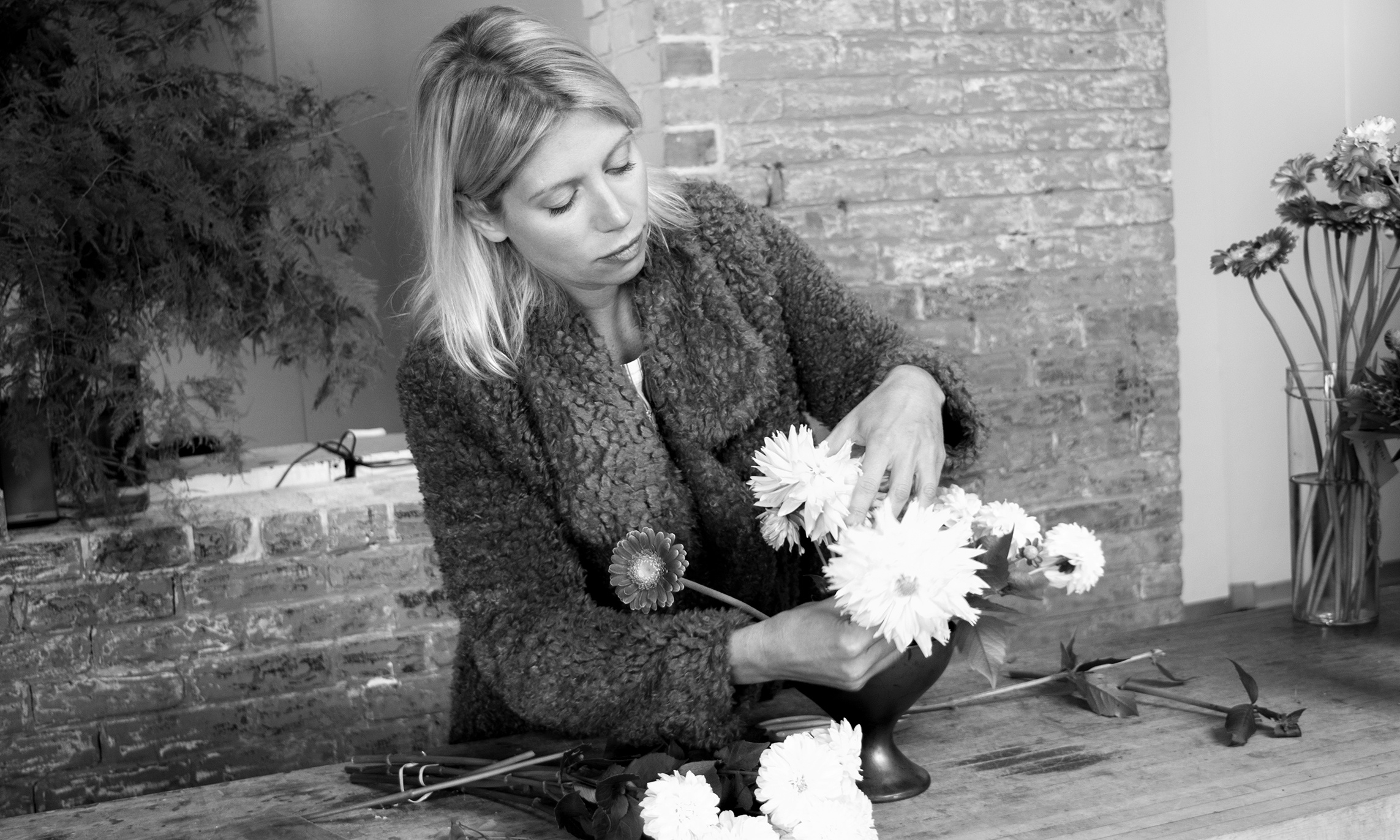 Semia Dunne of Flowers by Semia, arranging in her design studio