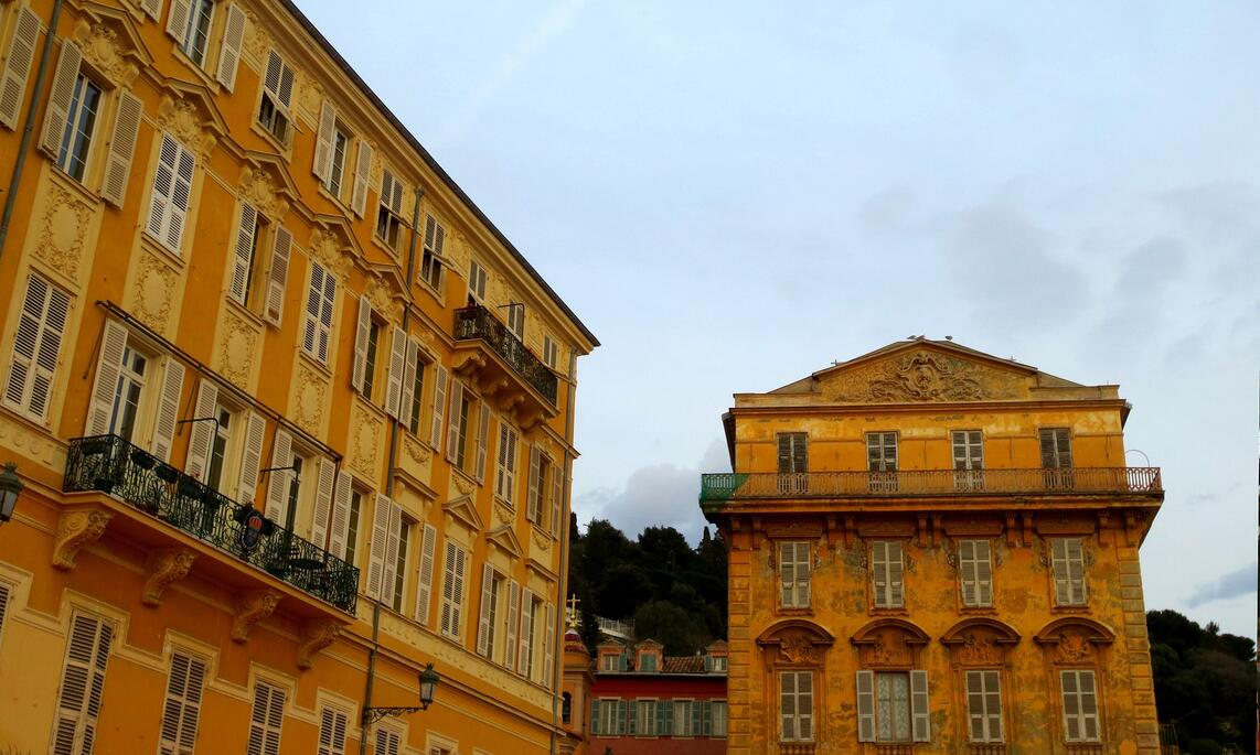 Belle Epoque yellow buildings in the Old Town of Nice, France