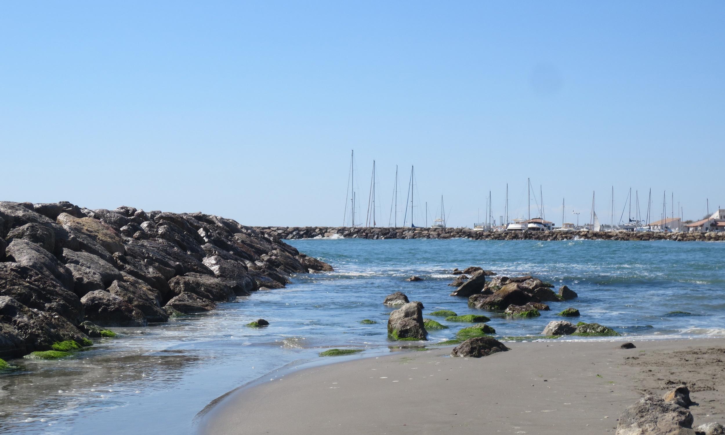 Distant sailboats in Saintes-Maries-de-la-Mer, France