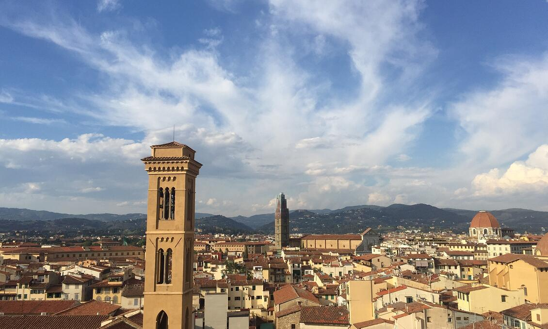 Rooftop panorama in Florence, with the Duomo visible off in the distance