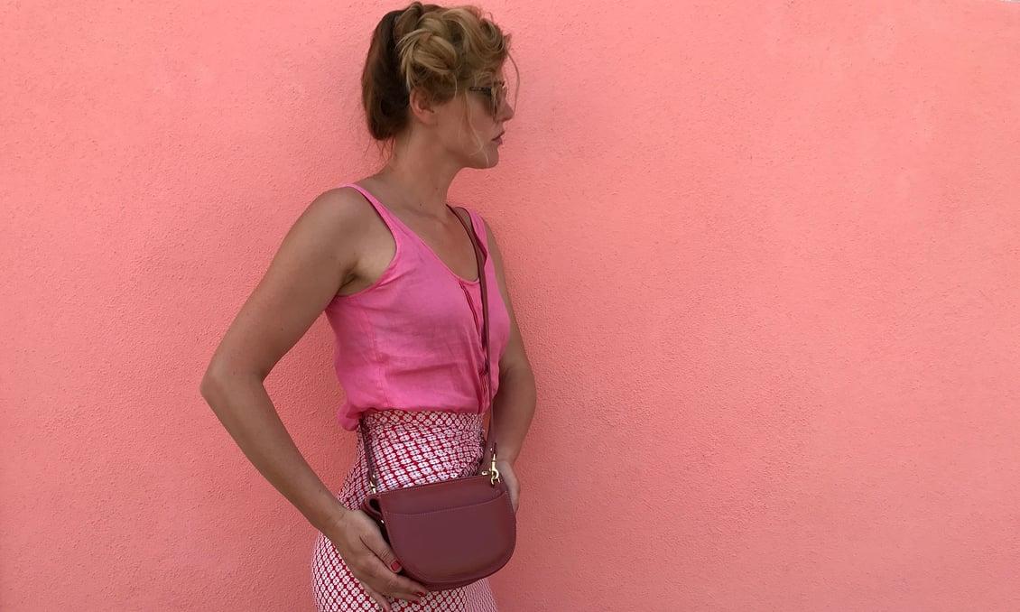 Willa in Italy with the Lotuff Mini Luna handbag in rosewood