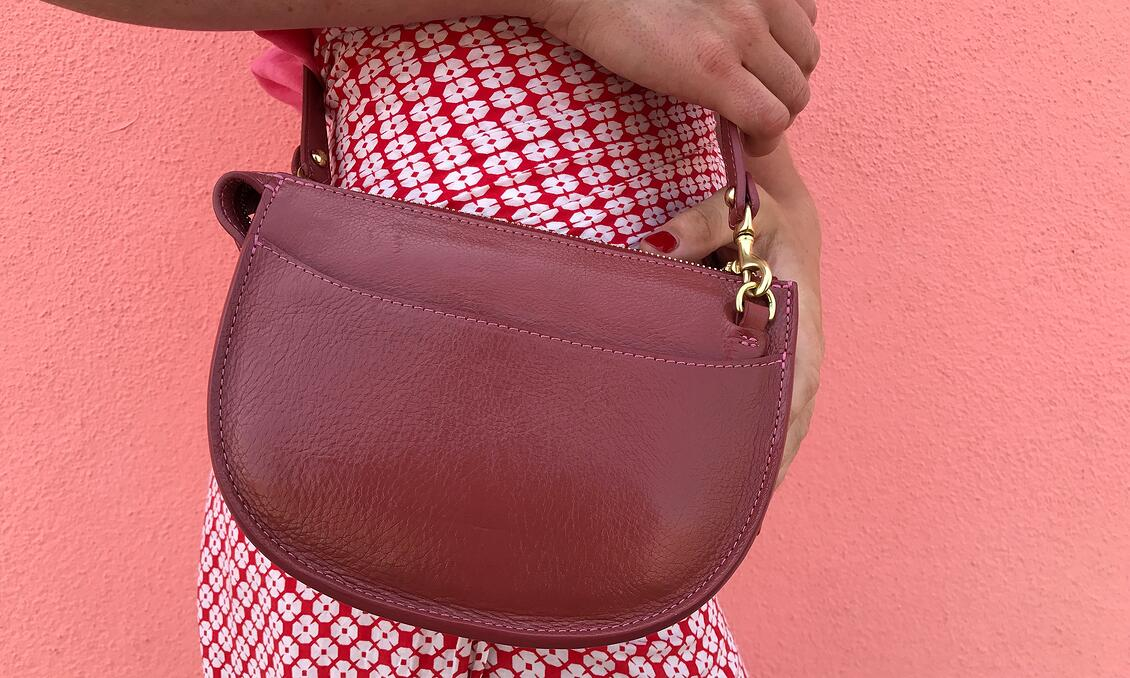 Close-up of Willa in Italy with the Lotuff Mini Luna handbag in rosewood